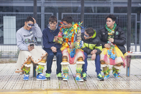 badajoz: BADAJOZ, SPAIN, FEBRUARY 9: Performers at San Roque Carnival parade at Badajoz City, on February 9, 2016. Young participants sat on bus stop Editorial