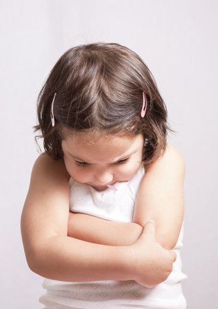 provoked: Angry three years old  little girl, sulking and pouting. Isolated over white background