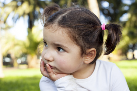 three years old: Thoughtful three years old little girl. Portrait outdoors