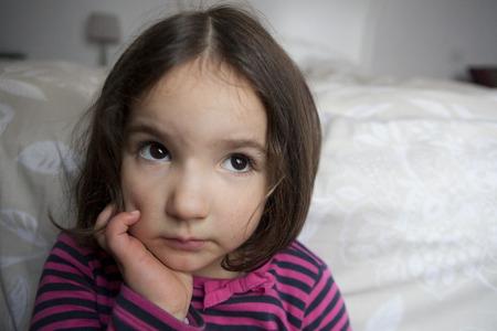 three years old: Hopeful three years old little girl. Indoors portrait