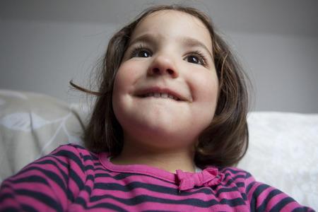 three years old: Hopeful three years old  little girl. Indoors portrait Stock Photo