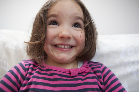 three years old: Naughty three years old  little girl. Indoors portrait