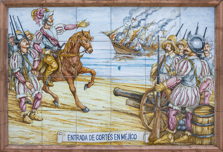 BADAJOZ, SPAIN, APRIL 16, 2015: Glazed tiles with America conquest scenes. Hernan Cortes burning the ships, on April 16, 2015, Spain