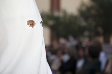bearer: Bearer or nazareno eyes, Holy Week Procession, Spain