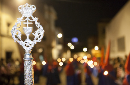 bearer: Bearer or nazareno holding a silver cane at Holy Week Procession, Spain