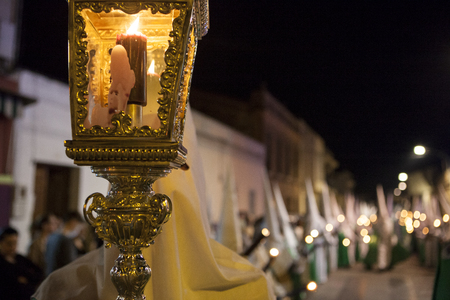 catholic symbol: Bearer or nazareno holding a cross at Holy Week Procession, Spain Stock Photo
