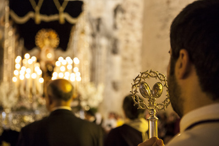 bearer: ALMENDRALEJO, SPAIN, APRIL 4: Bearer holding a silver cane during the return of Holy Week float to the church, Almendralejo, Spain, on April 4, 2015 Editorial