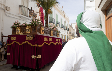 ALMENDRALEJO, SPAIN, MARCH 29: Costalero observing the Donkey float during Palm Sunday, Almendralejo, Spain, on March 29, 2015