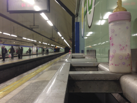 forgotten: baby bottle forgotten in underground railway