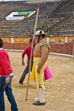 badajoz: BADAJOZ, SPAIN, MAY 11: Training bullfight behind closed doors, on May 11, 2010 in Badajoz, Spain. The lancer standing on the sand with his lance