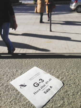 declaration: Badajoz, Spain - January 13, 2016: Spanish Tax Agency appointment entry ticket on the floor of building. After tax declaration