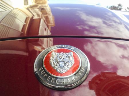 engine bonnet: Badajoz, Spain - February 7, 2016: Logo of the brand Jaguar on car with building reflections at engine bonnet