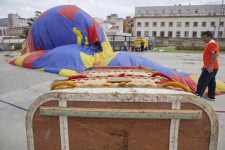adventure aeronautical: Badajoz, Spain - November  2, 2014: hot-air balloon basket on the ground deflating