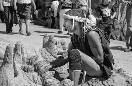 costumed: BADAJOZ, SPAIN - SEPTEMBER 25: Costumed sand man scultor working at the Almossasa Culture Festival on September 25, 2013 in Badajoz, Spain