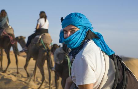 erg chebbi: Tourists on the desert trip near Merzouga in Erg Chebbi in Morocco