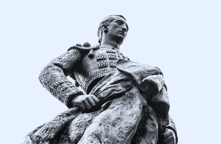 capote: Statue of a bullfighter, in the exterior of the city of Coprdoba, Spain Stock Photo