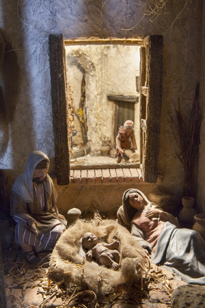 gospels: Badajoz, Spain - January 4, 2013: Holy Family resting after Birth of Jesus. Diorama built by Local Association of Friends of Cribs, Badajoz, 2013