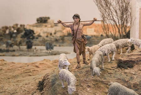 diorama: Badajoz, Spain - January 4, 2013: Young Shepherd at rise. Diorama built by Local Association of Friends of Cribs, Badajoz, 2013