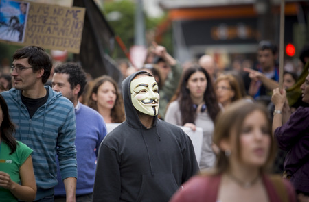 protester: Badajoz, Spain - March 29, 2012: anonymous protester at against austerity cuts demostration, March against the Labor Reform approved by the Government of Spain on March 2012