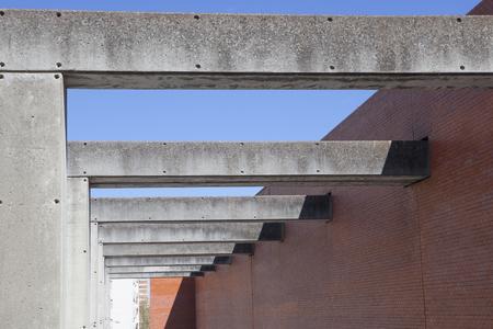 badajoz: Badajoz, Spain - April 1, 2016: MEIAC Museum building. Situated on the area of the former prison of Badajoz, redesigned by JA Galea. Concrete pillars Editorial