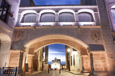badajoz: Hight square of Badajoz,  illuminated by led lights at twilight. Arco del Peso or Weight Arch