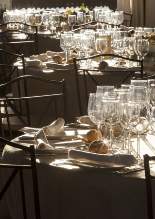 glint: Wedding tables full of glint dishware against the sunlight