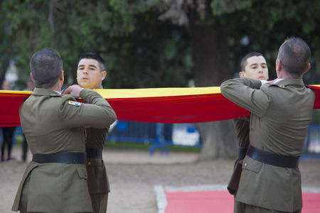 badajoz: Badajoz, Spain - May 25, 2016: spanish troops during the Armed forces day. Flag lowering