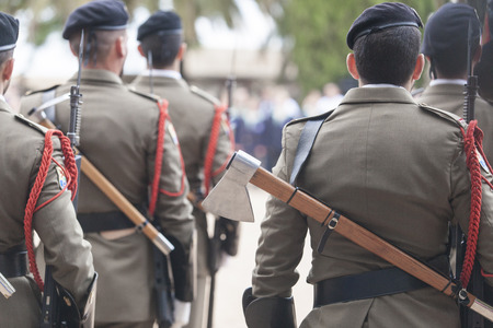 badajoz: Badajoz, Spain - May 25, 2016: spanish troops during the Armed forces day. Axes on back