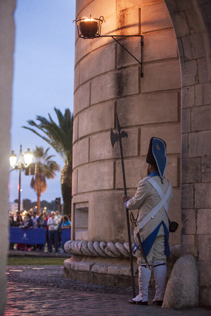 halberd: Badajoz, Spain - May 25, 2016: spanish troops during the Armed forces day. 16th Infantry Regiment Castilla period dressed guards at Palms door