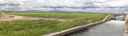 hugh: Hugh irrigation canal flows over the fertile meadows of High Guadiana or Vegas Altas, Extremadura, Spain. Panoramic shot