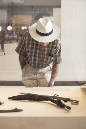 falcata: Madrid, Spain - July 11, 2016: Elder man with hat at National Archeological  Museum of Madrid