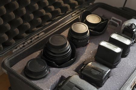 Digital camera equipment shockproof case over wooden background Stock Photo