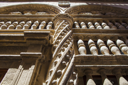 latticework: Baroque stone decoration beside the Royal Chapel outdoors at Granada Cathedral, Spain
