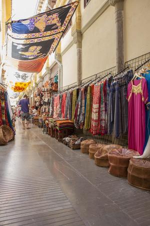 moorish clothing: Granada, Spain - August 5, 2016: Narrow streets filled with shops called Alcaiceria, originally home to a Moorish silk market, Granada, Spain