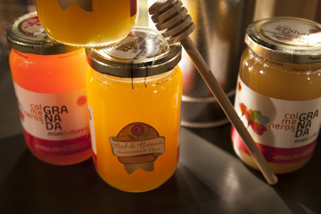 wares: Granada, Spain - August 5, 2016: Stand with traditional wares of honey, typical product from Granada Alpujarras Region, Spain Editorial