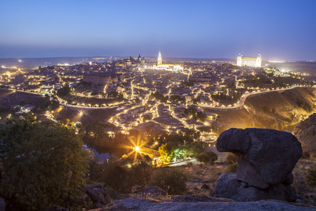 mancha: Old town cityscape with Alcazar and Cathedral at night, Toledo, Spain