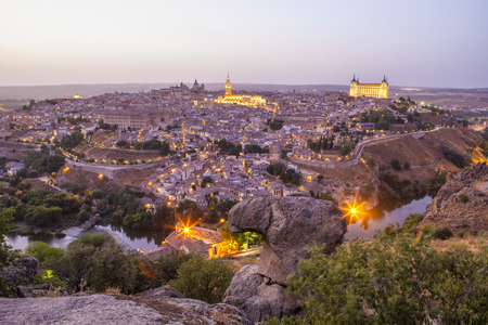 the tagus: Old town cityscape with Alcazar and river Tagus at twilight, Toledo, Spain