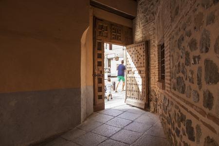 passageway: Tourists crossing an old passageway, Toledo city, Spain