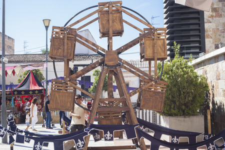 openair: Badajoz, Spain - September 24, 2016: Human powered wooden ferris wheel operated by hand at Almossasa Medieval Festival