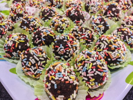 trifles: Plated shot of candy topped chocolate balls. Closeup