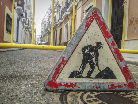 Road signs in a street under reconstruction symbol in old town. Traffic sign outdoors