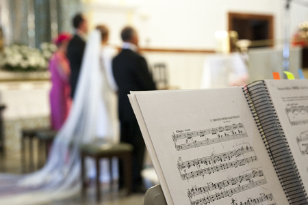 musique partition: Music score over stand during the wedding ceremony in a church. Selective focus