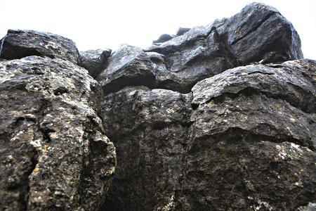 vastness: El Torcal De Antequera in the fog, Malaga, Spain. Unusual stunning rock formation Stock Photo