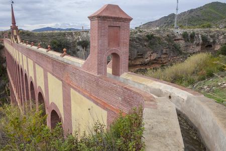 nerja: Aqueduct Puente del Aguila or Eagle Bridge in Nerja, Malaga, Spain. Canal view