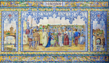 plaza of arms: Seville, Spain - January 3, 2017: Glazed tiles wall of spanish province of Caceres at Plaza de Espana, Seville, Spain