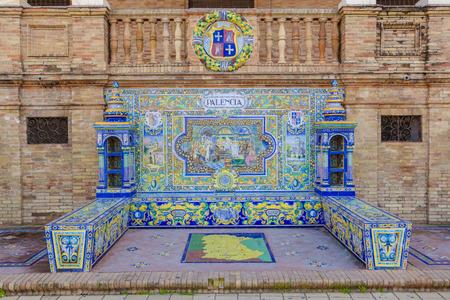 plaza of arms: Seville, Spain - January 3, 2017: Glazed tiles bench of spanish province of Palencia at Plaza de Espana, Seville, Spain