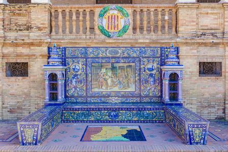 plaza of arms: Seville, Spain - January 2, 2017: Glazed tiles bench of spanish province of Lerida at Plaza de Espana, Seville, Spain