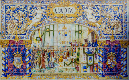plaza of arms: Seville, Spain - January 3, 2017: Glazed tiles wall of spanish province of Cadiz at Plaza de Espana, Seville, Spain