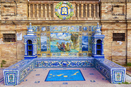 canarias: Seville, Spain - January 3, 2017: Glazed tiles bench of spanish province of Canarias at Plaza de Espana, Seville, Spain