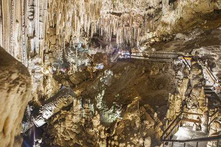 unidentified: Unidentified visitors in the Famous Magnificent Nerja Caves, Andalusia, Spain Editorial